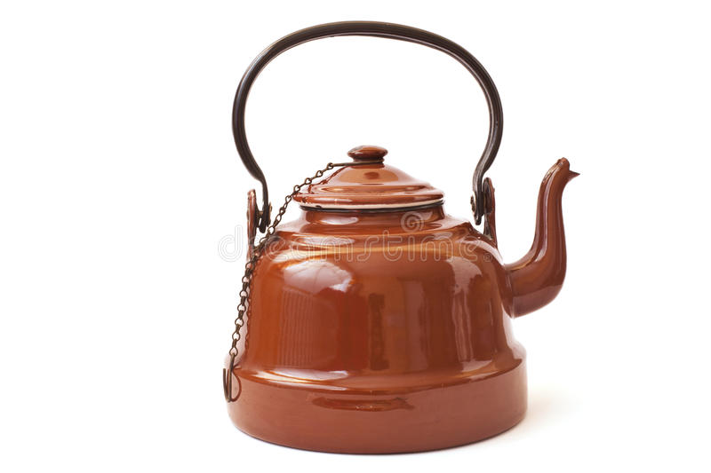 Old brown kettle. Isolated on white stock photography