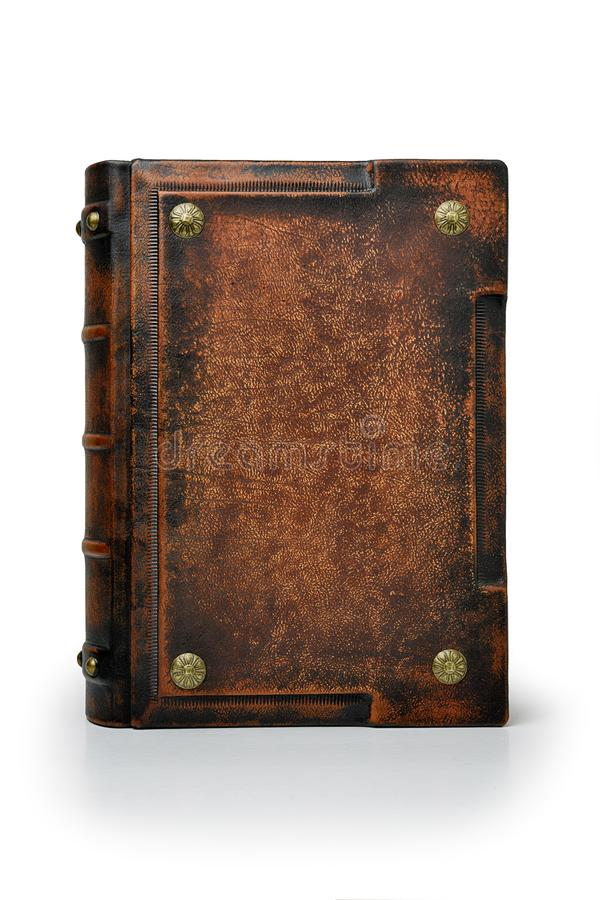Old brown leather book with metal pins stand up to the table isolated. Old brown leather book with metal pins and ribs on the book spine stand up to the table royalty free stock images