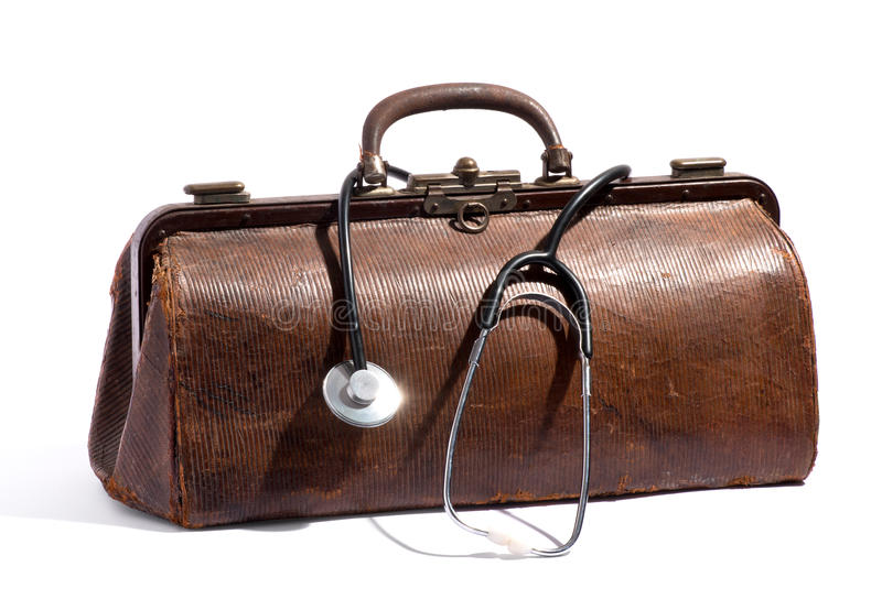 Old brown leather doctors bag and stethoscope stock images
