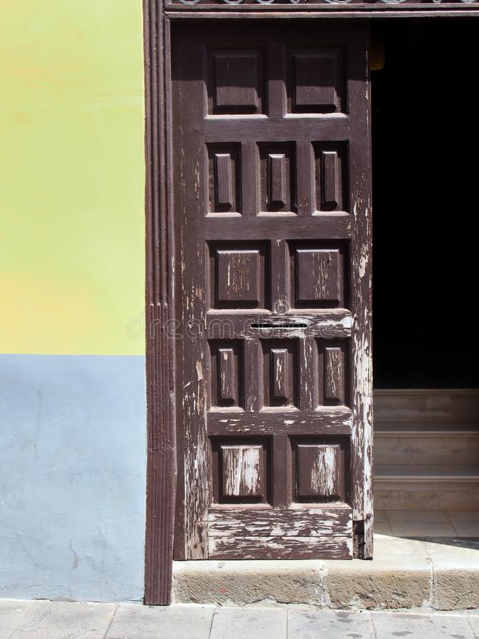 Old brown painted wooden door open with stairs inside royalty free stock images