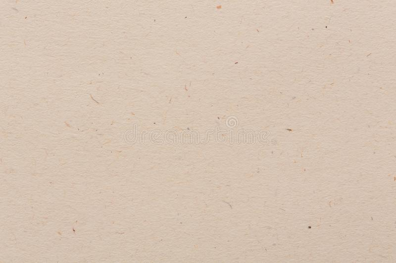Old brown paper background with vintage texture layout, off white or cream background color. royalty free stock photo