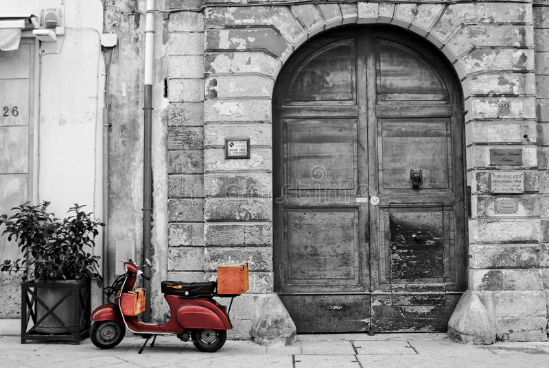 Old Brown Vespa against Old buildings stock photo