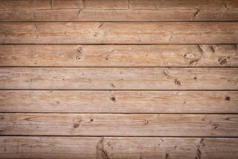 Old brown wooden boards with vignette. As a background royalty free stock photography