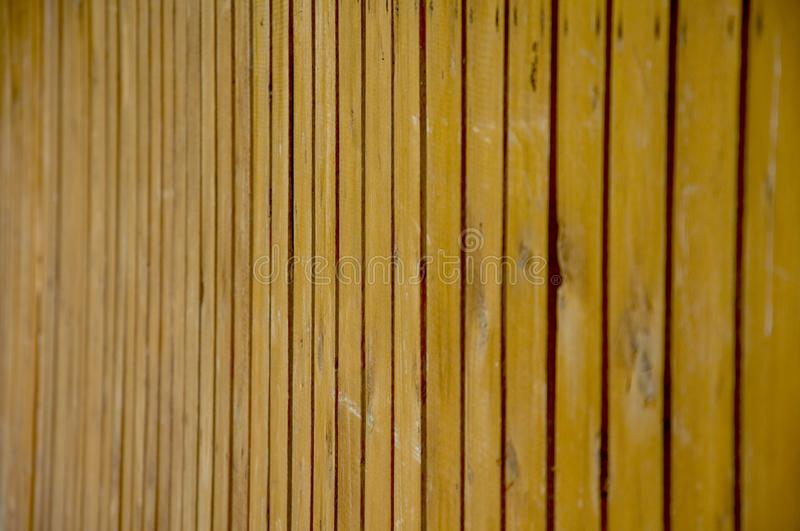 Old brown wooden fence made of boards. Wood texture royalty free stock images