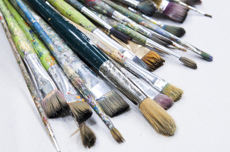 Old brushes for painting. Different brushes for fine art isolated close-up stock photo