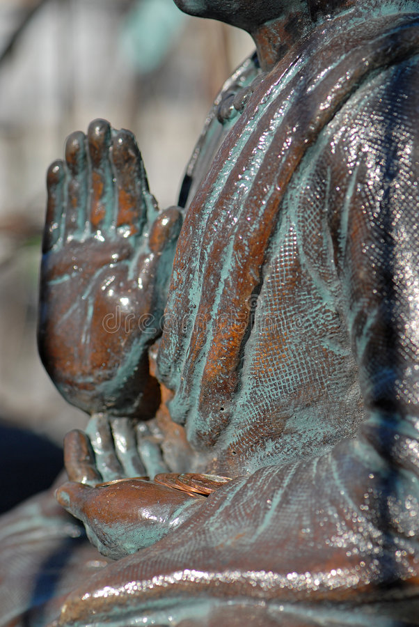 Download Old Buddhist Statue Holding Coins Stock Image - Image: 1340753