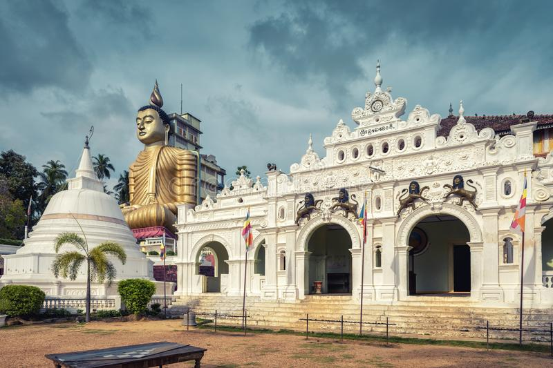 Old Buddhist temple in Dickwella, Sri Lanka. Wewurukannala Vihara is the old Buddhist temple in the town of Dickwella, Sri Lanka. A 50m-high seated Buddha statue stock images
