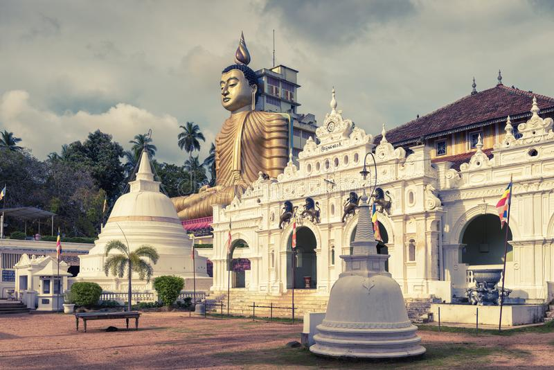 Old Buddhist temple in Dickwella, Sri Lanka. Wewurukannala Vihara is the old Buddhist temple in the town of Dickwella, Sri Lanka. A 50m-high seated Buddha statue stock image