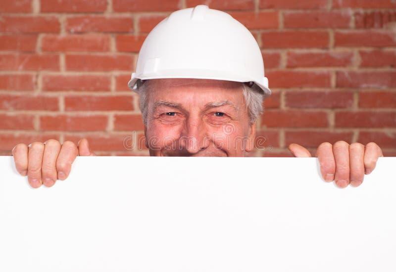 Old builder in the helmet stock images