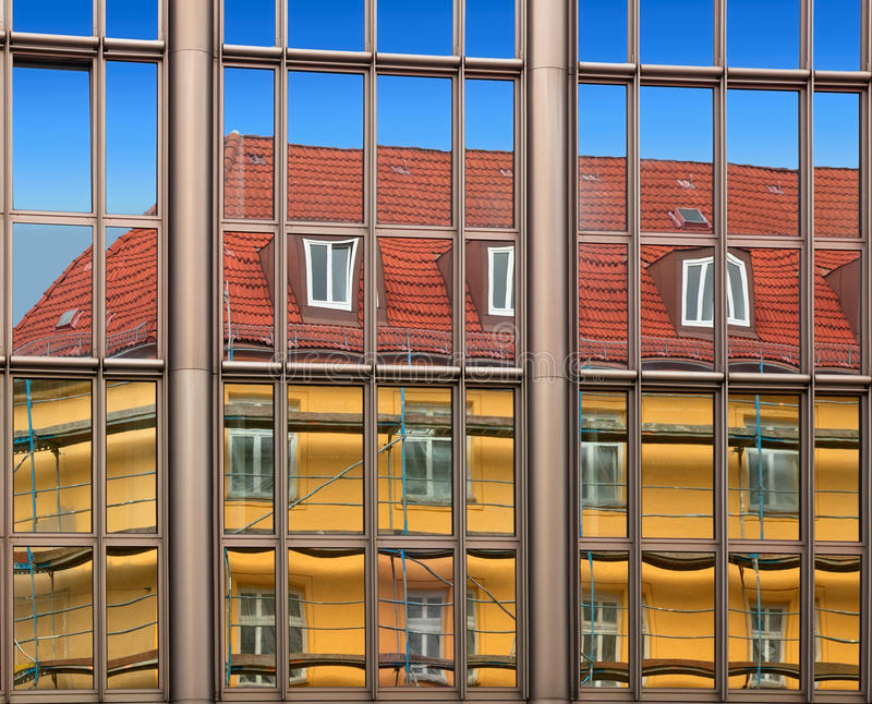 Old building architecture reflected in modern building stock photos