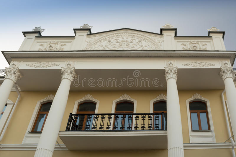 Old building with balconies and sculptures in Yaroslavl royalty free stock image