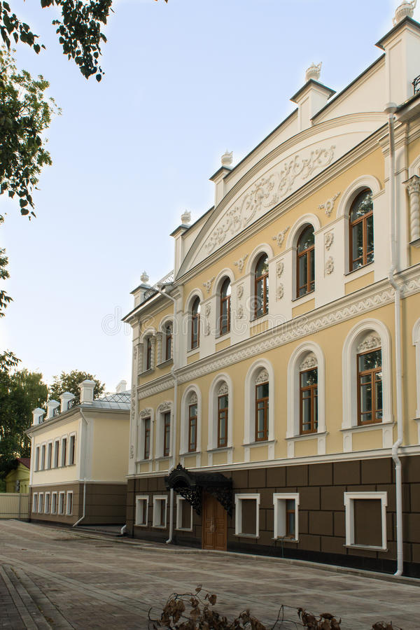 Old building with balconies and sculptures in Yaroslavl stock image