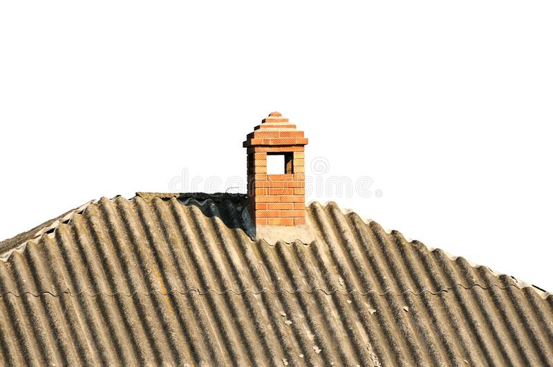 Old building with brick chimney. Covered slate royalty free stock photo