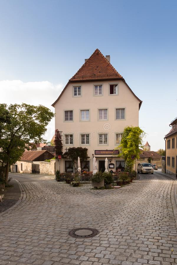 Old Building with a cafe, and a cobblestone road stock image