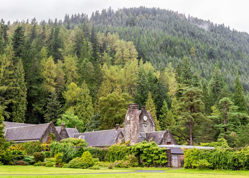 An old building with clock with an exhibition of local artists paintings for sale at Benmore Botanic Garden, Scotland. An old building with clock with an royalty free stock images