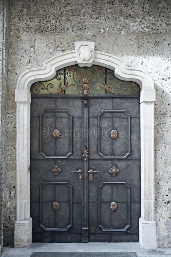 Old building door. Old historical decorative building metal door, mysterious concept stock images