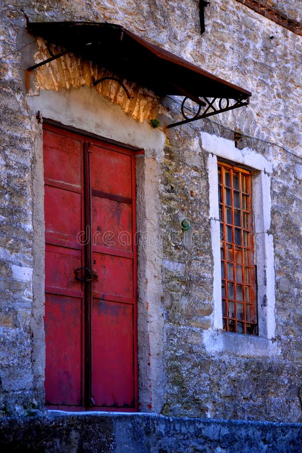 An old building with a door stock images