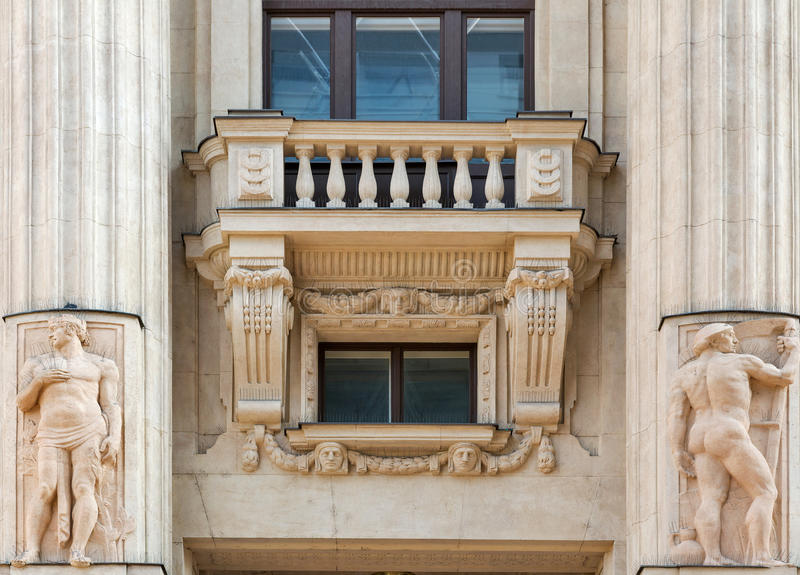 Old building exterior with balcony and columns in Budapest, Hungary. Old building exterior with balcony, columns and bas relief closeup. Vorosmarty ter square stock images