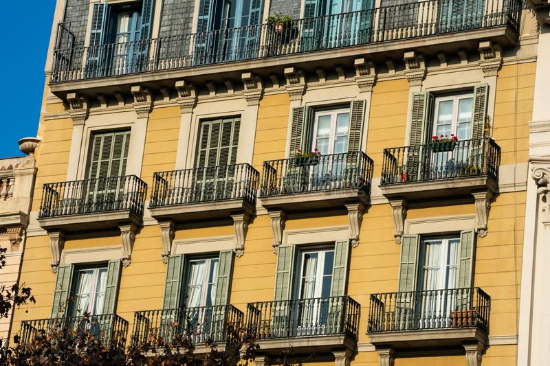 Old building facade and balconies on Passeig de Gracia Avenue. Barcelona, Spain. February 9, 2019. Old building facade and balconies on Passeig de Gracia Avenue royalty free stock image