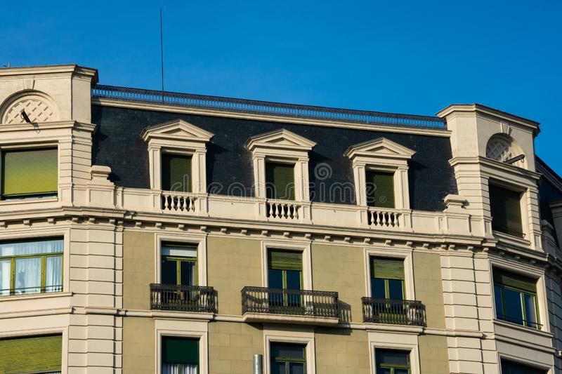 Old building facade and balconies on Passeig de Gracia Avenue. Barcelona, Spain. February 9, 2019. Old building facade and balconies on Passeig de Gracia Avenue stock photo