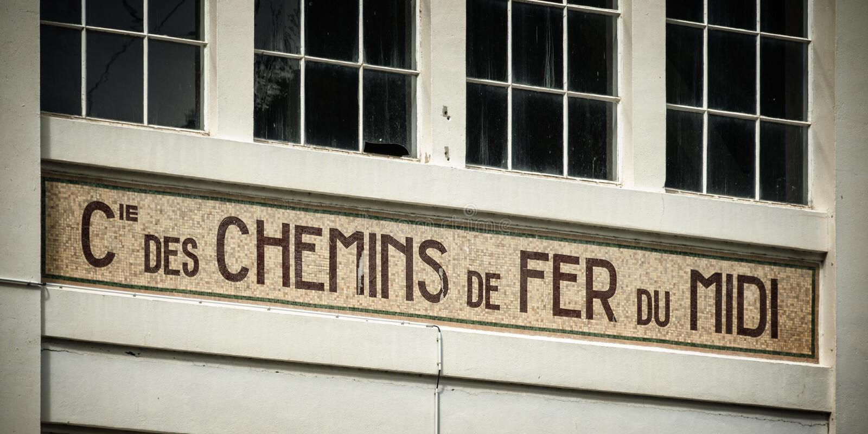 Old building facade of chemins de fer du midi stock images