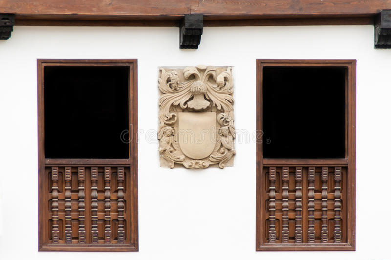 Old building facade with a coat of arms