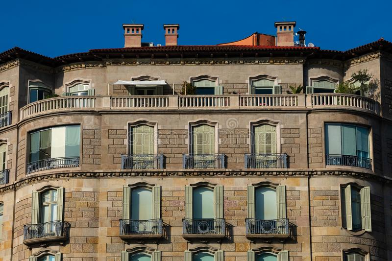 Old building facade on Diagonal Avenue and Passeig de Gracia. Barcelona, Spain. February 9, 2019. Old building facade on Diagonal Avenue and Passeig de Gracia stock images