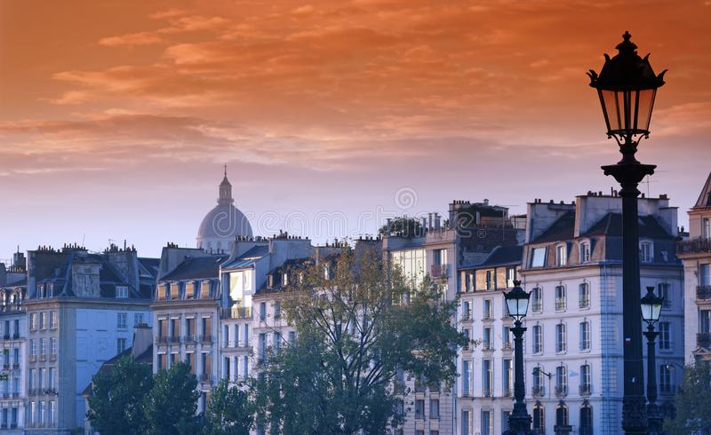 Old building facades in Paris. Old building facades and Pantheon dome in Paris city royalty free stock photos