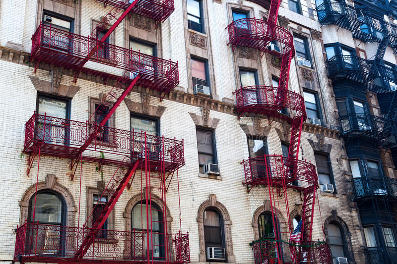Old building with fire escape stairs in Soho, NYC royalty free stock images