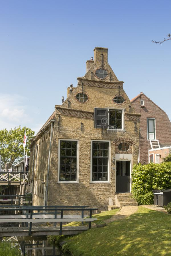Old building in a historical city in the lake side district of the Netherlands. Hindeloopen, one of the eleven cities in the province of Friesland in the North royalty free stock images