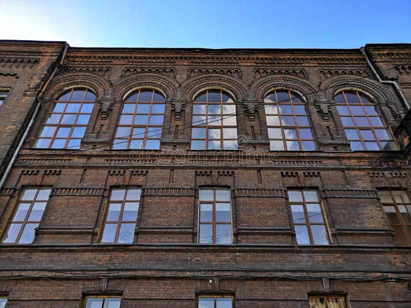 Old building with large Windows, red brick stock photo