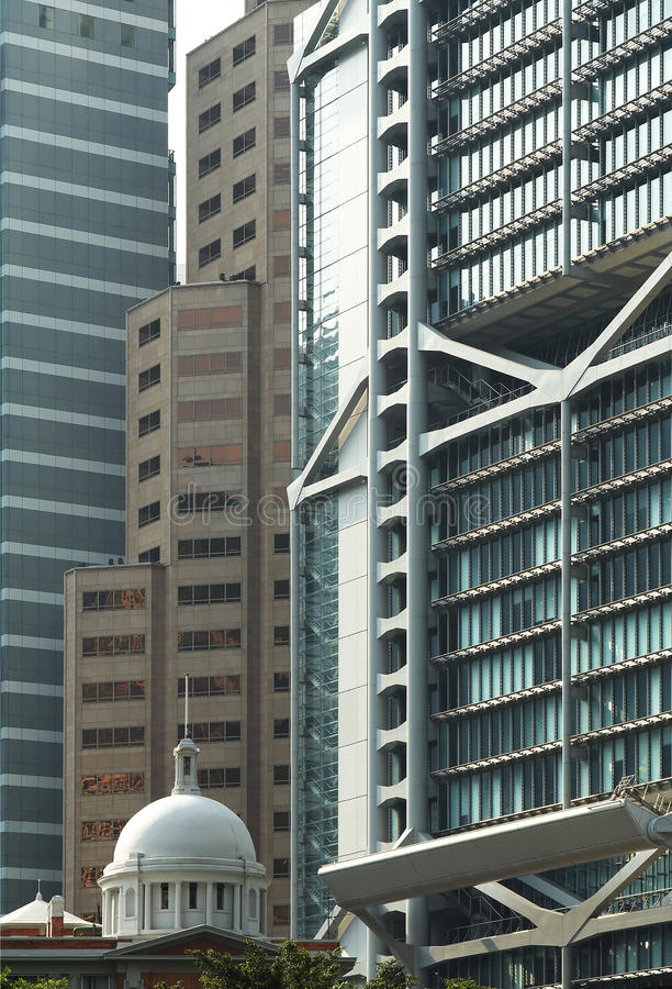 Old building among modern skyscrapers