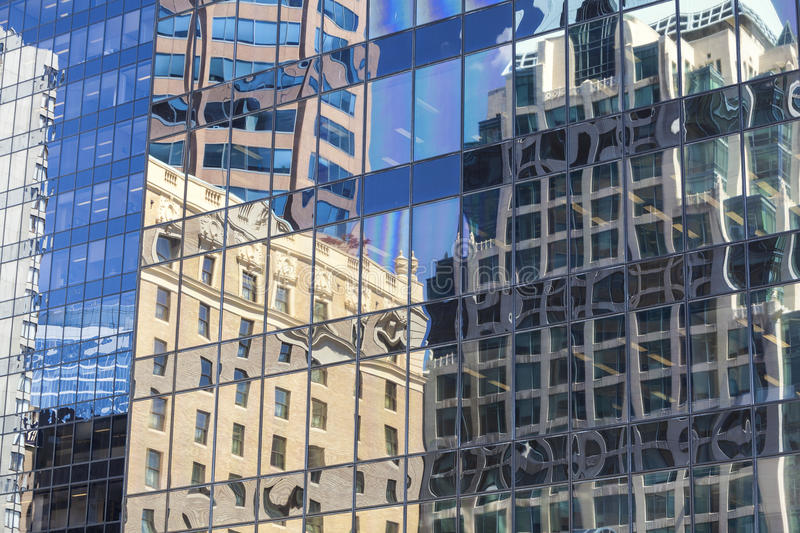 Old Building Reflections in Windows of Modern Office. Reflections of old buildings in the windows of modern city office building tower stock images