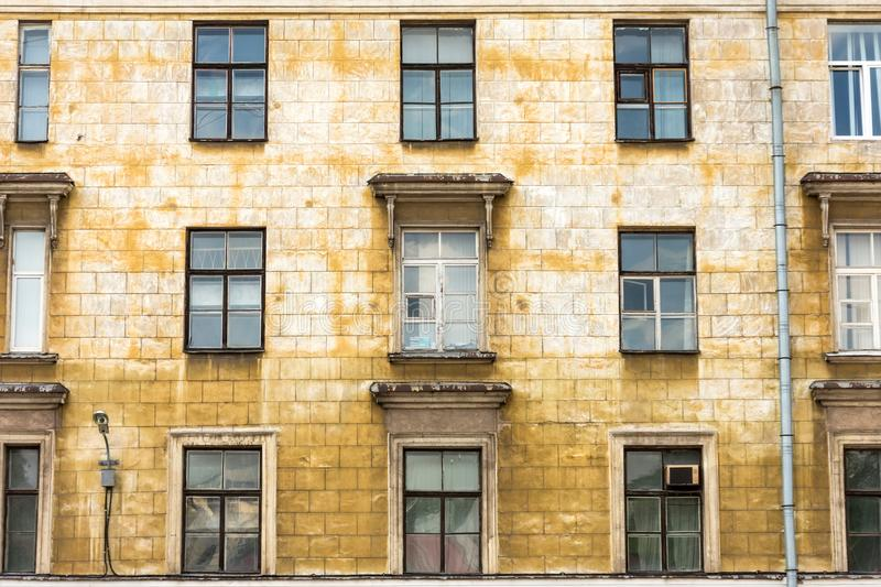Old building requiring repair in bad condition windows and balconies. Old building requiring repair in bad condition windows and balconies stock image