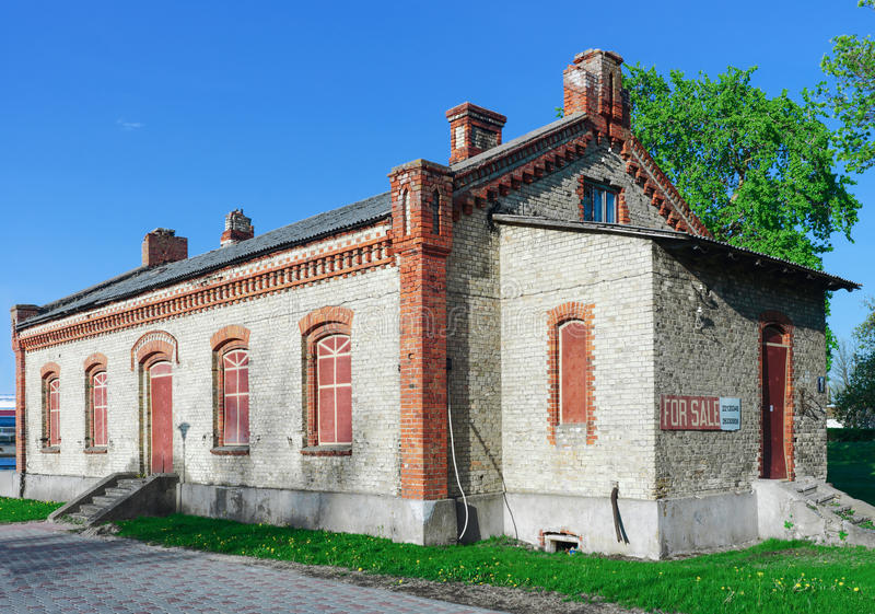 Old building for sale in the Center of Ventspils in Latvia. Ventspils, Latvia - May 8, 2016: Old building for sale in the Center of Ventspils in Latvia. It is a royalty free stock images