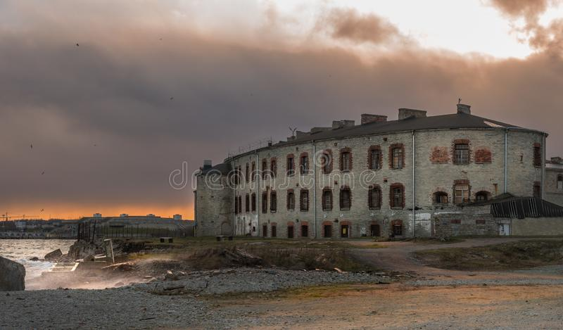 Old building on the shore of the Summer Harbor in Tallinn, Estonia. Bastion. On the windows are iron bars. Autumn. Evening in the harbor. View of the city in royalty free stock images