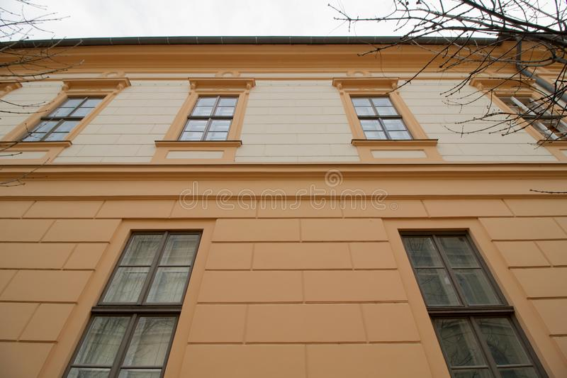 Old building in Szeged, Hungary. Renovated facade of a historic old building in Szeged, in the south of Hungary, Europe royalty free stock images