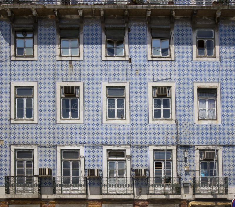 Download Old Building With Tiled Facade And Damaged Windows Stock Photo - Image: 25502950