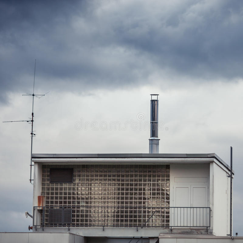 Old building under cloudy sky. Old glassy building under cloudy sky stock photo