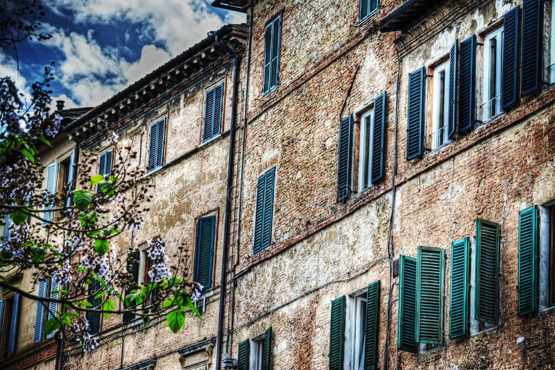 Old building under a cloudy sky in Siena. Italy royalty free stock image