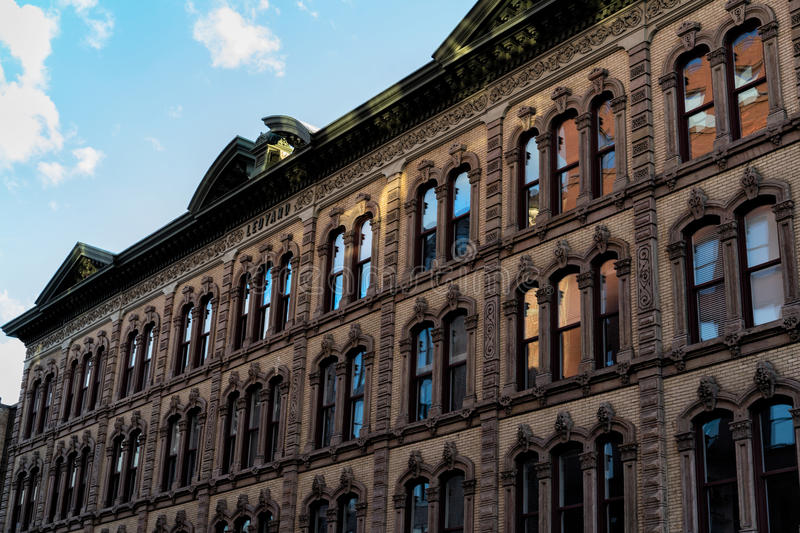 Old building, with windows reflecting light. An old building in Grand Rapids, Michigan, with light reflecting on the windows royalty free stock photos