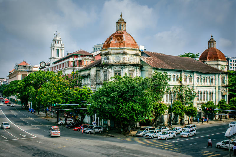 Ancient building with colonial design, at the corner of Pansodan Street and Strand Road in Yangon, Myanmar, may-2017 royalty free stock images
