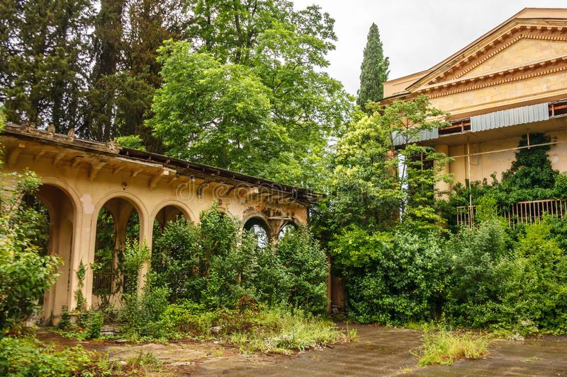 Old buildings in Abkhazia overgrown with grass and greenery.  royalty free stock image