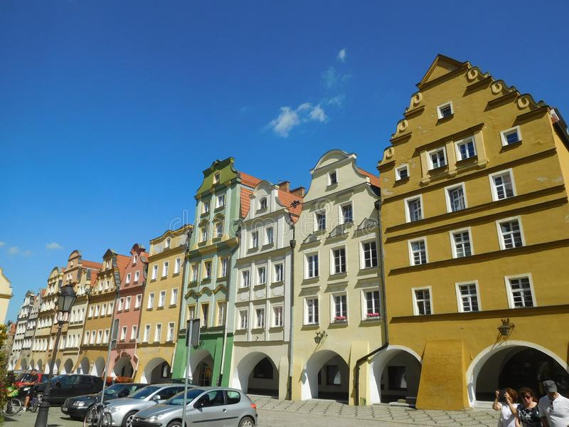 Old buildings on the central square in Jelenia Gora, Poland. Old coloured buildings on the central square in the typical style stock images
