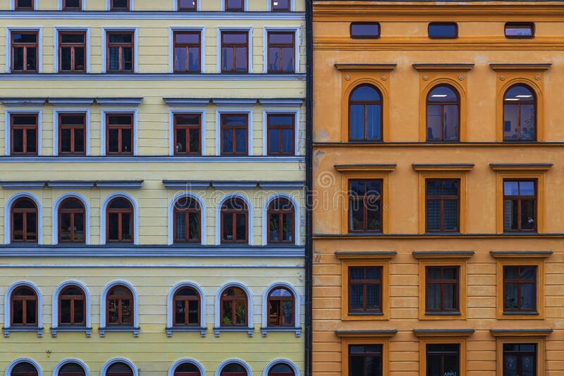 Old buildings facades in Prague city, Czech Republic. Old buildings yellow and orange facades in Prague city, Czech Republic stock photos