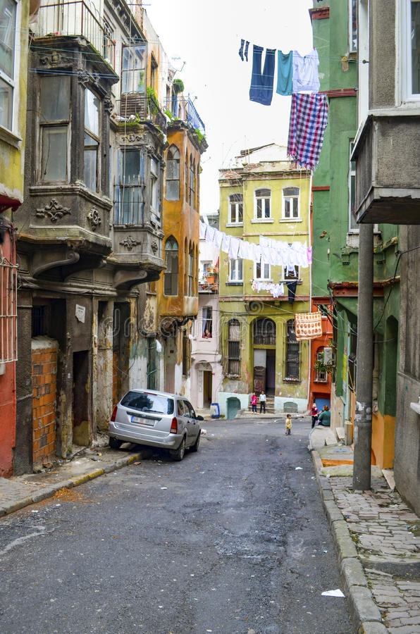 Old buildings and local people in Tarlabasi. Istanbul, Turkey - March 12, 2013: Image of old buildings Buildings and local people in Tarlabasi. The district is a royalty free stock photo