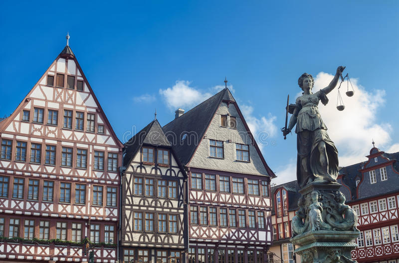 Old buildings and statue of Lady Justice statue in Frankfurt. Frankfurt am Main, Germany - February 5, 2015: photo of statue of Lady Justice, known as the Roman royalty free stock image