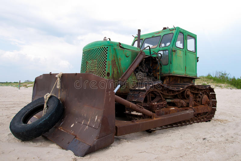 Old bulldozer. Old seaside bulldozer used for pulling fishing boats up the beach and for beach maintenance royalty free stock images