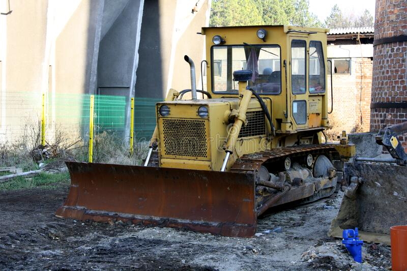 Old bulldozer. Abandoned on a construction site royalty free stock photos
