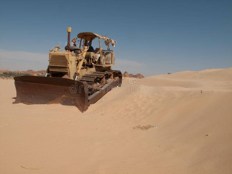 An old bulldozer abandoned in the middle of the desert in Saudi Arabia stock images